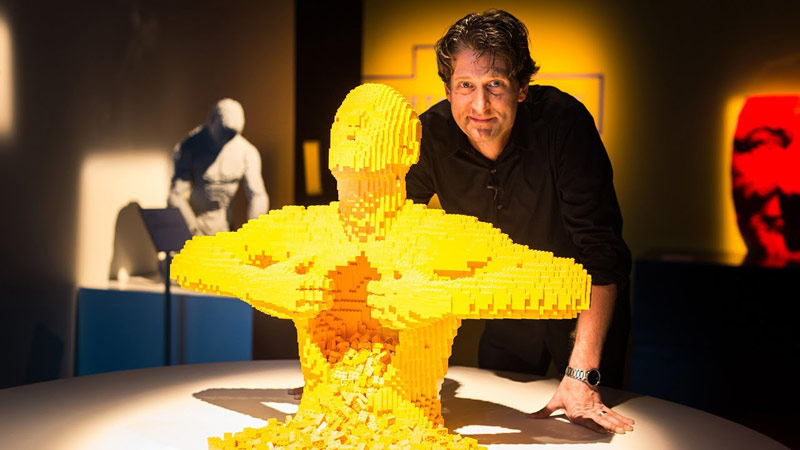 The brickartist Nathan Sawaya with one of his three-dimensional sculptures at the Art of the Brick exhibition